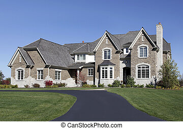 Large home in suburbs with cedar roof