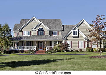 Large home with front porch and cedar roof
