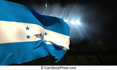 Large honduras national flag waving on black background with...