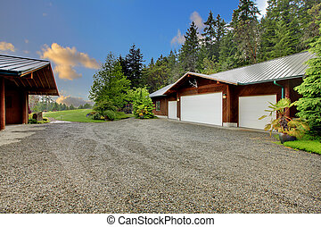 Large horse farm with garage and house