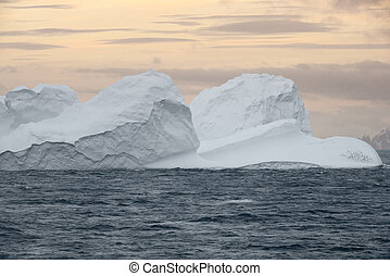Large Iceberg floating at sunset in Bransfield Strait near the northern tip of the Antarctic Peninsula, Antarctica