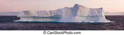 Large Iceberg Floating in Sea