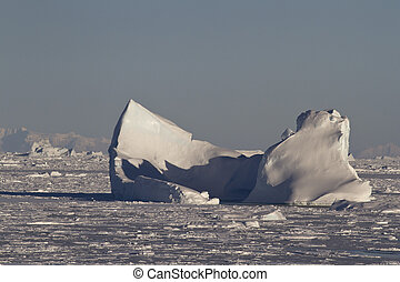 large iceberg stuck in the Strait clogged with ice in the Antarc