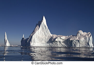 large iceberg with a few tops off the coast of Antarctica