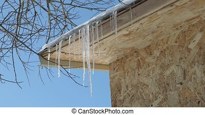 large icicles on the roof close-up