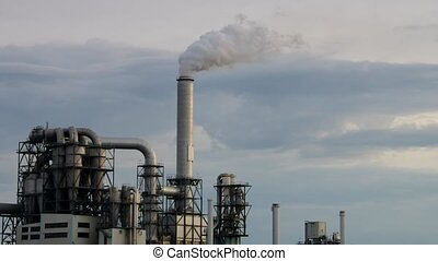 large industrial plant and smokestack - large industrial...