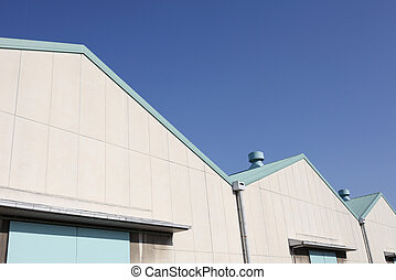 warehouse - Large industrial warehouse against a blue sky