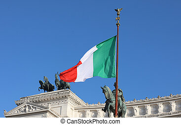 Italian flag flying Majestic on the National Monument called Alt