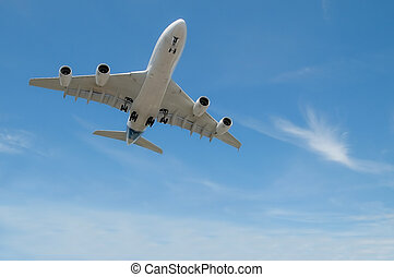 large jet aircraft on landing approach in a cloudy blue sky