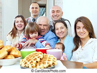 large joyful three generations family