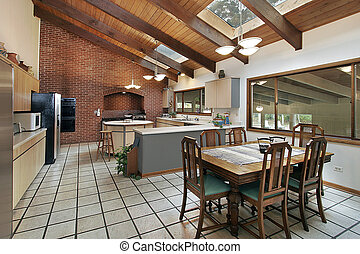 Large kitchen with skylights - Kitchen with skylights and...