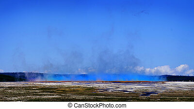 Large Landscape in Yellowstone with Steam Rising and People to Give Scale