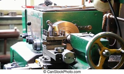 Large lathe in work. The man turns the valve and starts...