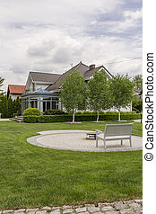 Large lawn and bench in the backyard
