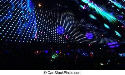 large LED screen size of entire wall with changing picture in nightclub