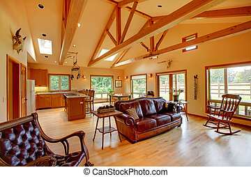 Large living room on the horse ranch with the kitchen. -...