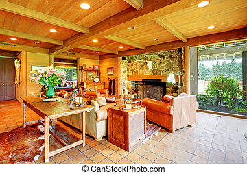 Cowboy ranch in Washington State with leather sofas and stone fireplace.