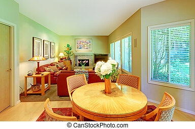 Large living room with breakfast table near kitchen.
