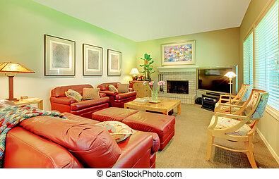 Large living room with leather sofas, fireplace and TV