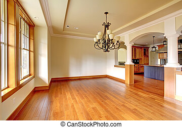 Large luxury dining room interior with kitchen and arch.