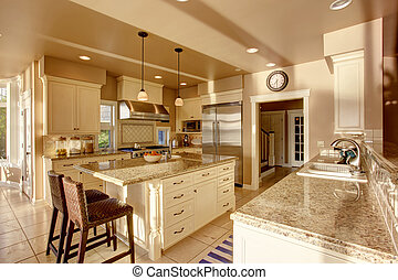Large Luxury Kitchen Room In Beige Colors With Granite Counter Tops And Tile Floor