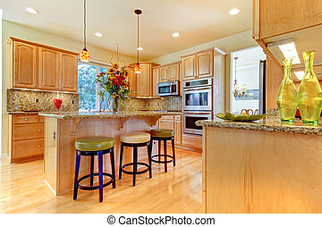 Large luxury maple wood kitchen with island and stools