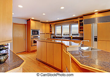 Large luxury modern wood kitchen with granite counter tops....