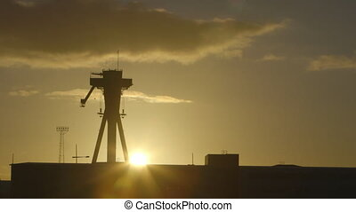 Large Machinery and Building Silhouette - Steady, exterior,...
