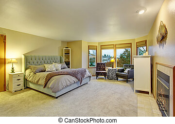 Large master bedroom with fireplace.