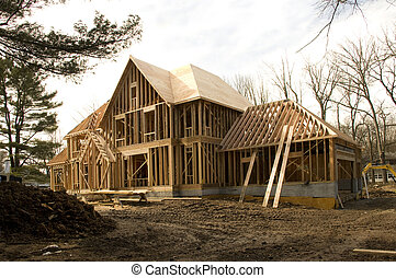 McMansion type house under construction in framing phase - ...