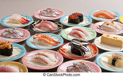 Large meal of shushi sashimi with shrimp, salmon, tuna, squid and makerel