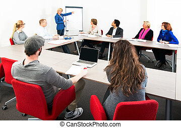 Large meeting - Several businesspeople meeting in a spaceous...
