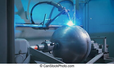 Large metal ball mounted on an automated machine for electro...
