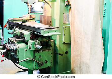 Large metal iron bench lathe, equipment for repair, work with metal in the workshop at the metallurgical plant in the repair production