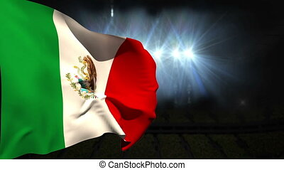 Large mexico national flag waving on black background with flashing lights