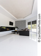 Large minimalist living room with a white shiny floor