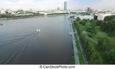 Large modern city center viewed from above. Beautiful of Yekaterinburg aerial view city with river, Russia