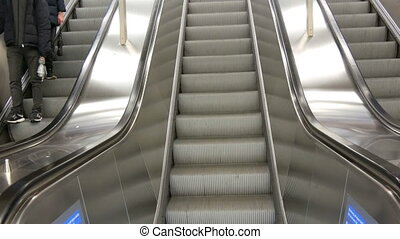 Large modern staircase escalator rides the subway up - A...