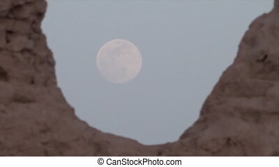 Large moon against a pale sky in Uzbekistan - A medium,...