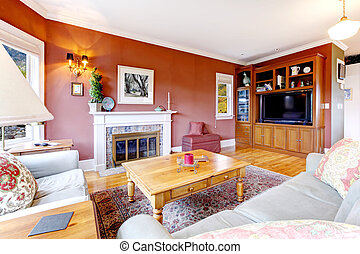 Large nice living room with red walls and fireplace.