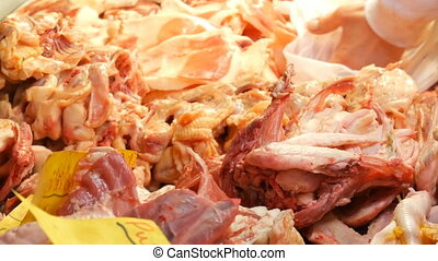 Large number of chicken giblets, entrails, wings, legs,...