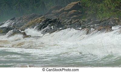Large ocean waves breaking on the rocks