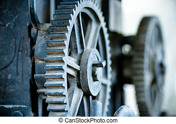 large old industrial gears set in blue metallic toning