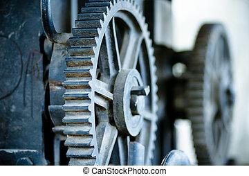 large old industrial gears set in blue metallic toning