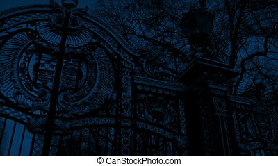 Large Ornate Gate At Night - Pan across ornate metal gates ...
