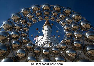 Large outdoor Five face Buddha statue on Khao Kho mountain at Wat Phra Sorn Kaew temple.