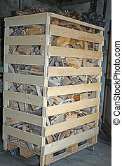 pallet with pieces of cut wood ready to be burned as heating dur