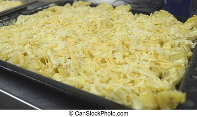 Large pan of potatoes with cheese for cooking in the oven, close-up, 4K