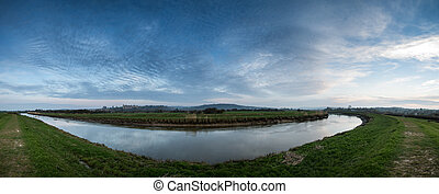 Large panorama landscape sunrise over countryside with medieval castle