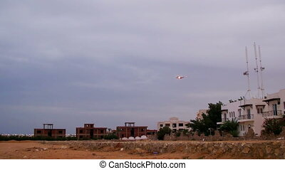 Large Passenger Plane Flying in the Sky over Hotels in Egypt